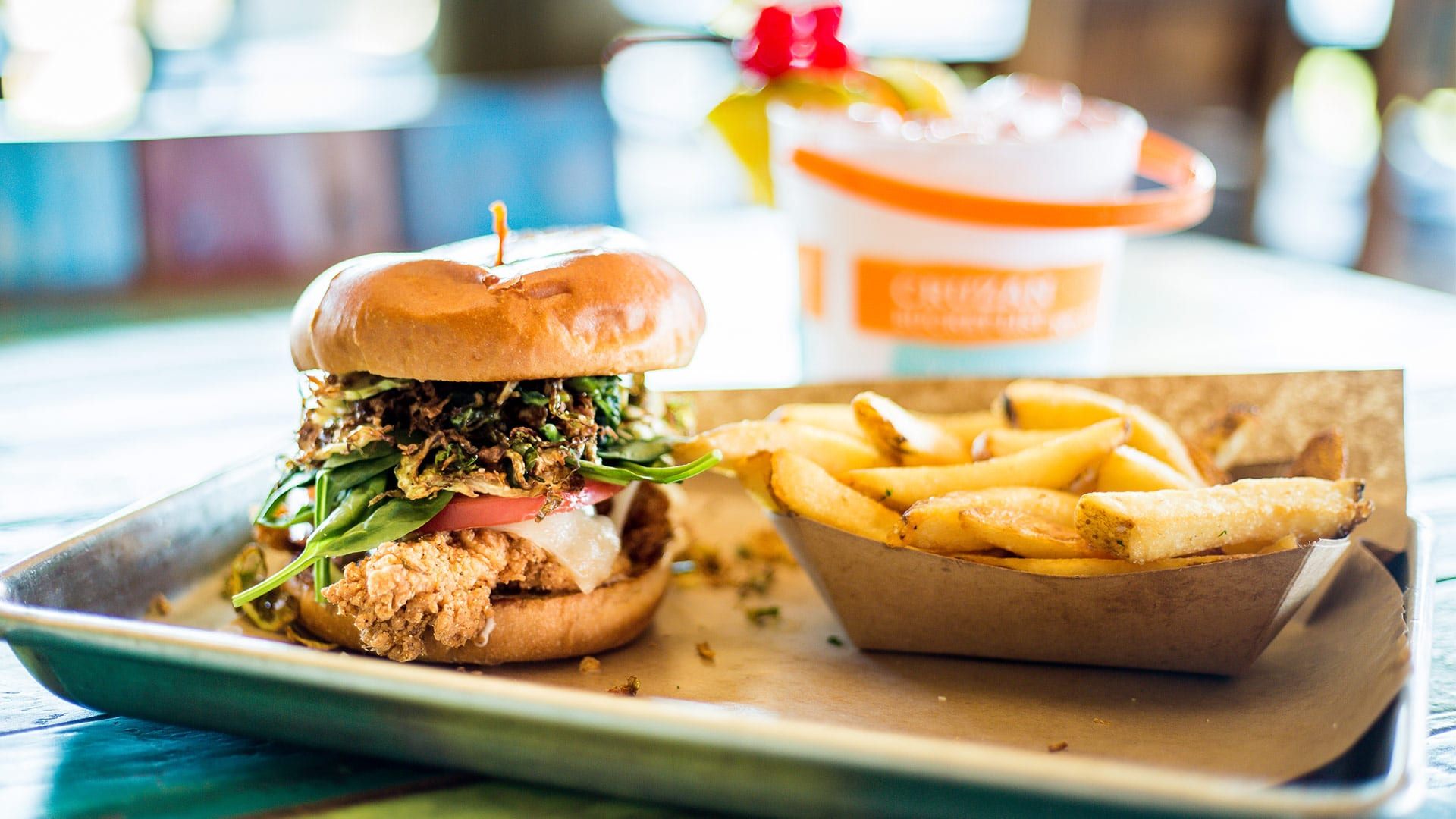 Between Buns | Crispy Chicken Brussels Burger | Red Fish Blue Fish Pensacola Beach